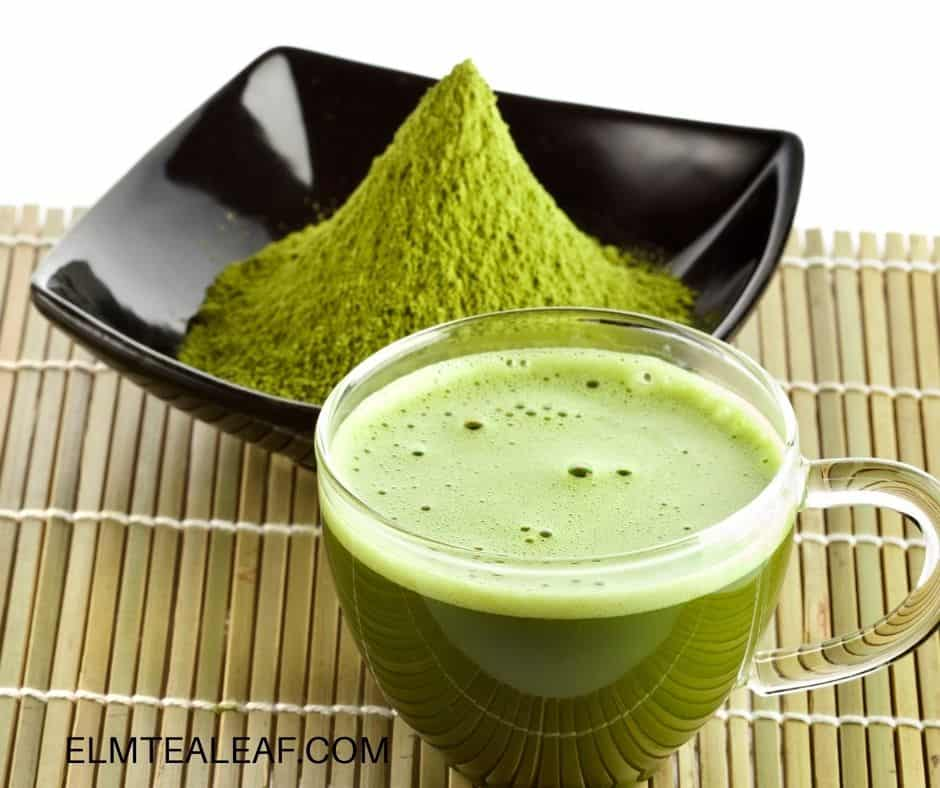 Clear Cup of Matcha Tea with bowl of matcha powder
