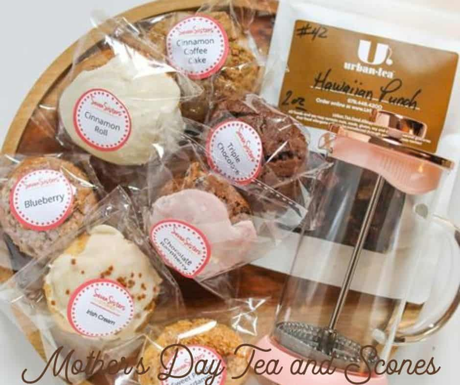 Basket with scones and tea and a tea drinking container.