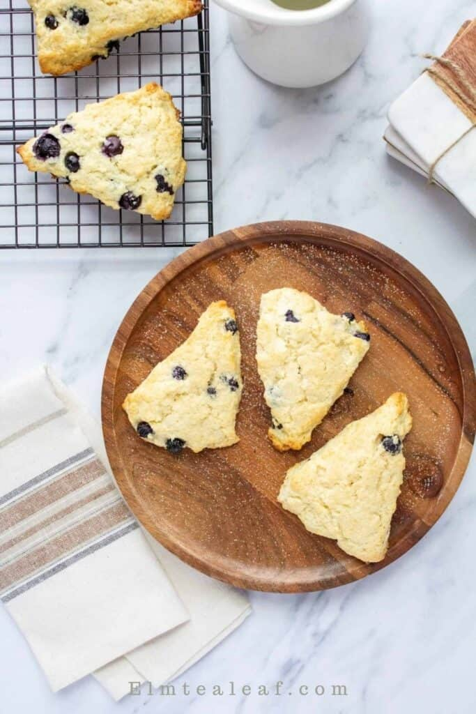 Plate of 3 blueberry scones plus napkins and baking rack