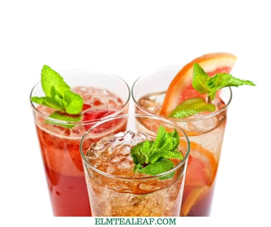 3 glasses of different flavor iced tea with citrus and mint .