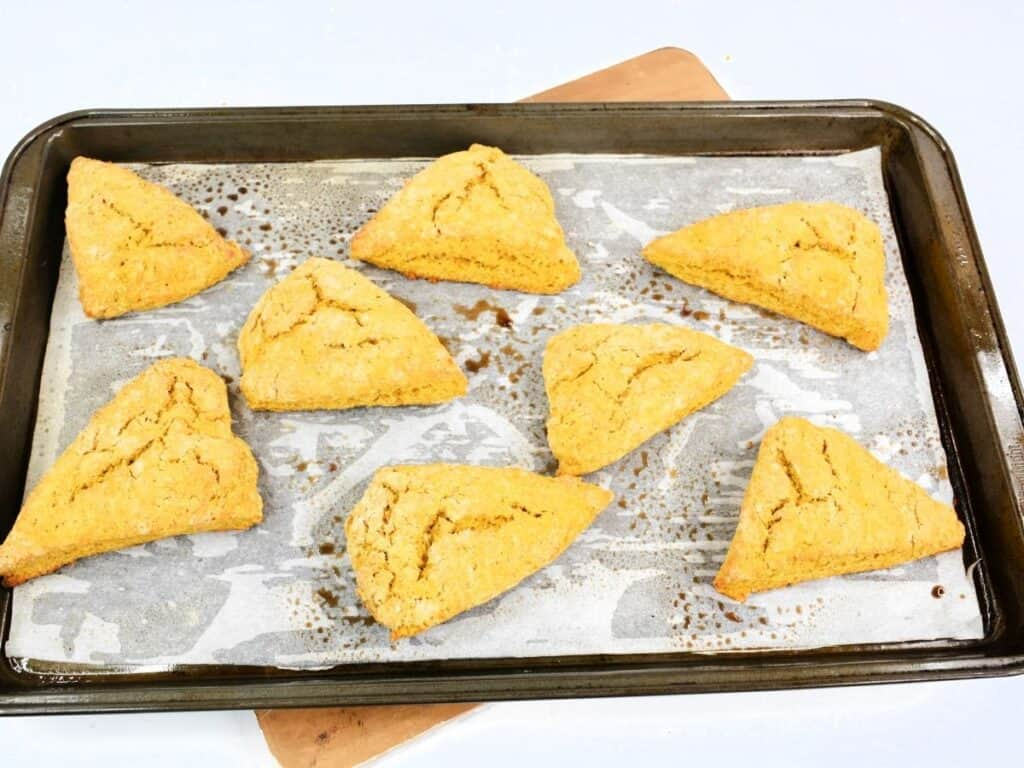 baked scones on a parchment paper on a baking sheet